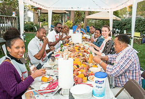 Friends Eating Low Country Boil