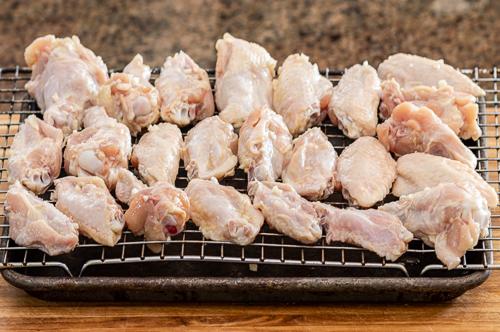 raw chicken wings on rack