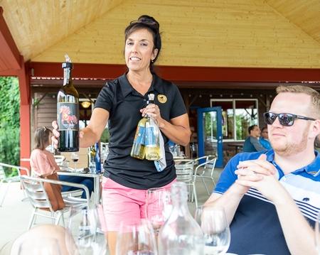 Lady holding wine bottles