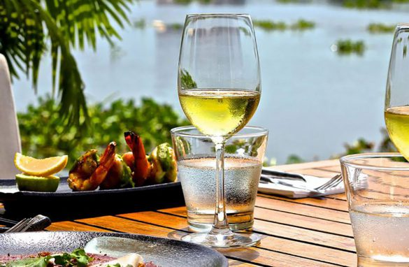 Wine and Seafood on Table Overlooking Water